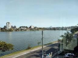 Apartamento de três dormitórios de frente para lagoa do violão em Torres