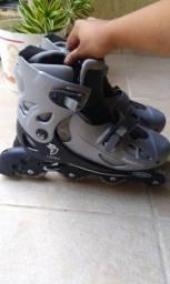 Vendo par de patins em bom estado,número 39/49