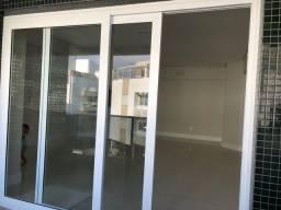 Porta de vidro com esquadria de PVC