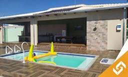 Linda casa com 3 suítes, mesa de sinuca, piscina e play groud. Cód. 1013