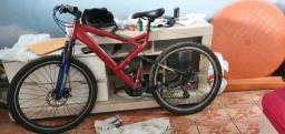 Bike com suspensão tripla