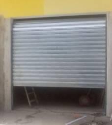 Vendo uma porta cortina de aço em bom estado