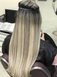Promoçao de aplicaçao de mega hair na tela.