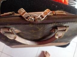 Vendo ou troco em celular essa bolsa grife Louis Vuitton