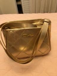 Bolsa dourada de couro Carmen steffens sem uso