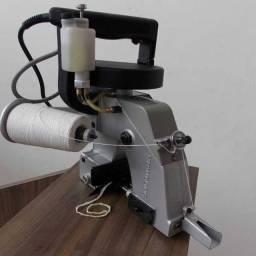 Máquina de costura portátil manutenção
