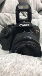 Câmera em excelentes condições, sem marca de uso
