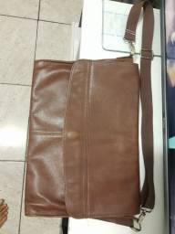 Bolsa de couro legítimo vale 590 quero 300