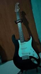 Guitarra/pedaleira com pedal de preção