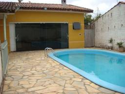 Vendo Casa em Colombo C/4 quartos Suite/Hidro dupla,Piscina aquecida 4x8,Terreno grande