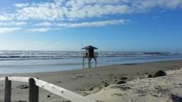 Casa em Atlântida Sul, 2 quadras do mar/amplo pátio/4 dorm/internet/tv a cabo