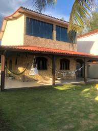 Casa de praia de frente para a praia com garagem