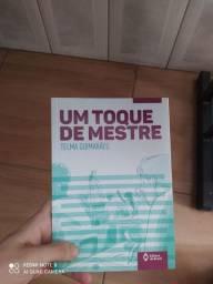 Livro Um toque de mestre (livro usado)