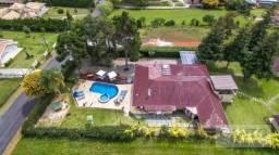 Casa com 6 dormitórios à venda em condomínio fechado, 550 m² por R$ 2.100.000 - Clube Curi