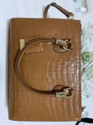 Bolsa de couro legítimo. Schutz