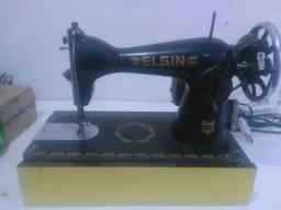 Máquina de costura elgim reta cabeça preta costurando perfeitamente