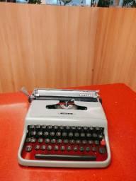 Funcionando disponivel na cor azul claro Maquina de escrever antiga - antiguidade