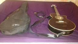 Vendê se um violão elétrico seminovo