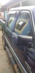 Vendo uma caminhonete L 200   ano 1998 .Motor a diesel.