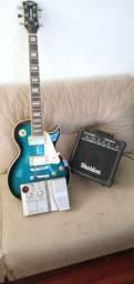 Guitarra, pedaleira e caixa