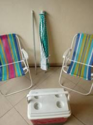 Conjuto de cadeira guarda sol e caixa termica