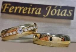 Par de alianças em ouro 18k e prata 950 com zirconias