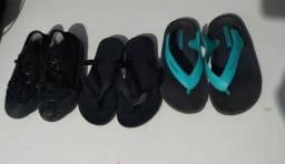 Dois calçados infantis e um sapado masculino
