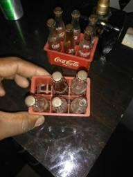 Garrafinhas da Coca cola coleção falta uma mais conservadas