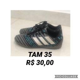 Chuteira adidas TAM 35