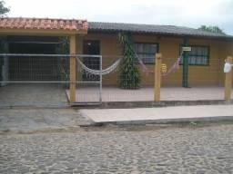 Vendo terreno com duas casas na Praia da Cal.