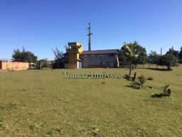 Casa com terreno de 90.785m², com vista para o mar, em Imbituba Litoral de SC