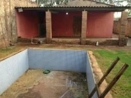 Casa com piscina 165 mil