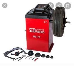 Desmotadora de pneu e balanceadora