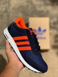 Tênis Adidas Azul com laranja novo