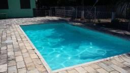 Sítio, espaço e piscina