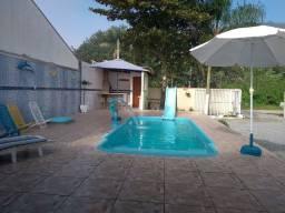 Casa com piscina em Caiobá