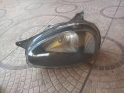 Farol esquerdo corsa apartir 94 original mascara negra