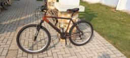 Vendo Bicicleta  de alumínio com amortecedor aro aero 26 e com marcha
