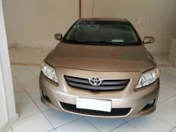 Corolla 2009 dourado metálico