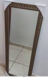 Espelho moldura em madeira. Medida 38x98 cm.