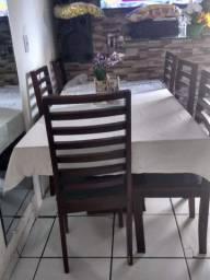 Mesa com 6 caseiras da Gravatá moves e tampo de vidro mendindo 1×2