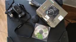 Máquina fotográfica nova na caixa