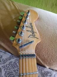 Troco esse guitarra por outra