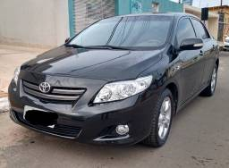 Toyota Corolla telefone para contato; 62- *