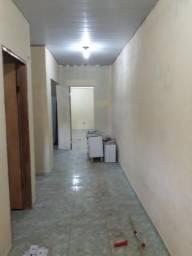 Casa com dois quartos sala, cozinha corredor, banheiros área de serviço