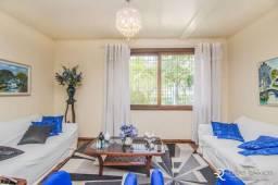 Casa com 3 dormitórios à venda, 294 m² por R$ 950.000 - Jardim Lindóia - Porto Alegre/RS