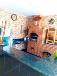 03-Casa com área de churrasco e lazer