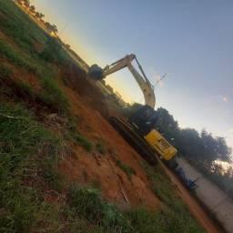 Escavadeira new holland 215