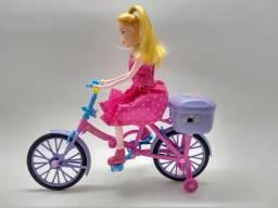 Boneca que anda de bicicleta , musical na caixa
