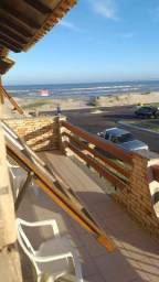 Apt na beira da praia